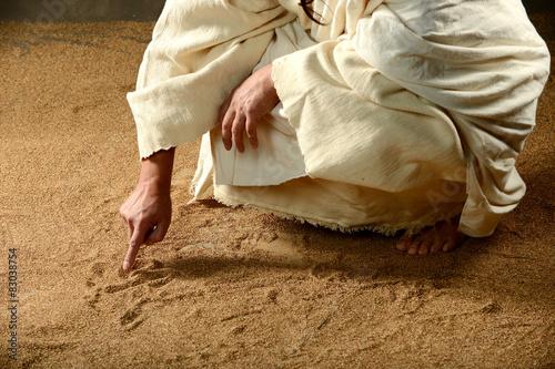 Fotomural  Jesús escribir en la arena
