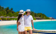 Young happy couple on white beach at summer vacation