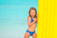 Little Girl With Air Mattress On Summer Vacation At Tropical