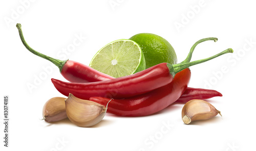 Red hot chilie pepper, garlic cloves, lime isolated on white