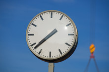 Clock With Hoist In Background