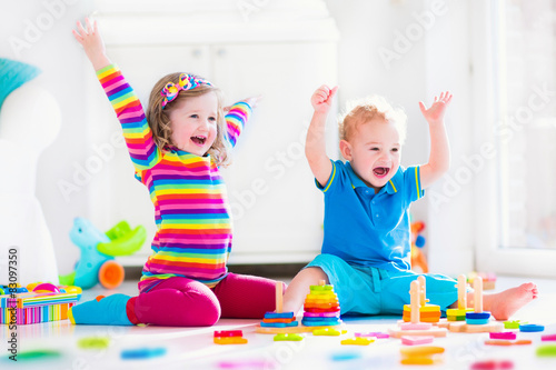 Valokuva  Children playing with wooden toys