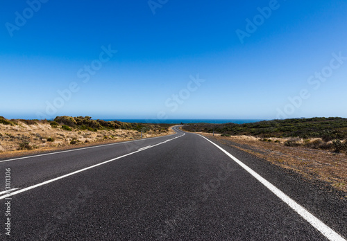 Foto op Canvas Australië The straight and bend road on the great ocean road in Australia