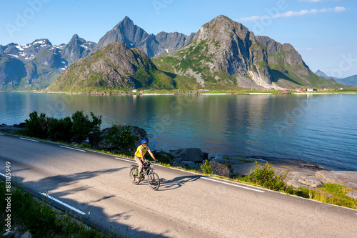 Fototapety, obrazy: Biking in Norway against picturesque landscape