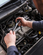 Close up of auto mechanic repairing an engine.