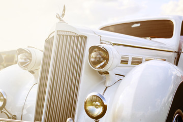 Fototapeta Vintage Retro car parked on grass