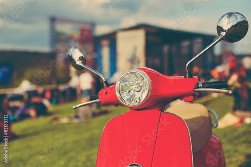 Scooter Red retro scooter on grass