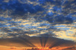 beautiful summer sunset with dark sky and sun