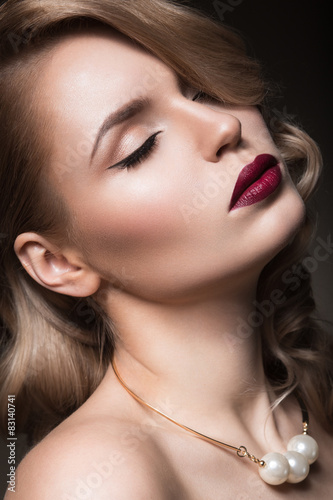 blonde in a Hollywood manner with curls Canvas Print