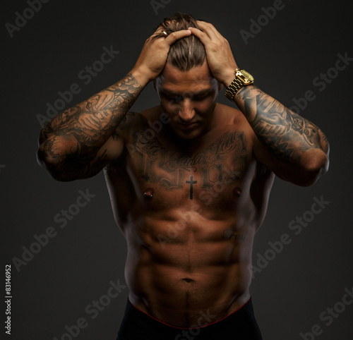 Muscular man with tattooes Wall mural