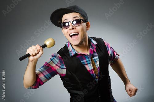 Fotografie, Obraz  Funny man singing in karaoke