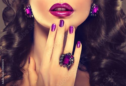 Staande foto Manicure Beautiful girl showing purple manicure and stylish jewelry