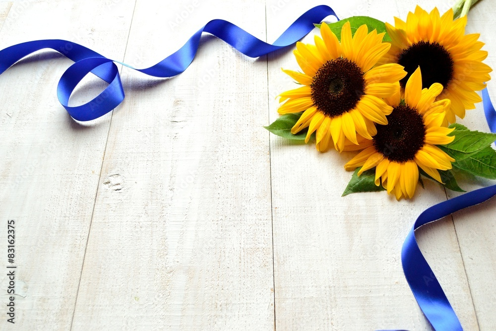 Sunflower bouquet with blue ribbon