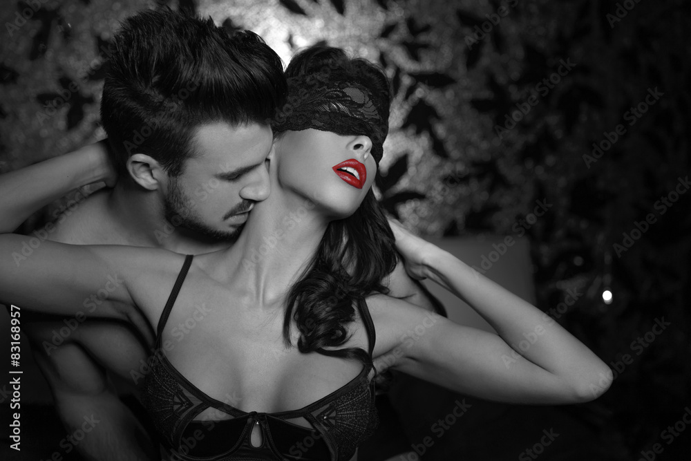 Fototapeta Passionate couple foreplay at night selective coloring