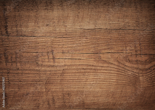 Dark brown scratched wooden cutting board. Wood texture - 83175907