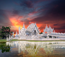 """Sunset Time White Temple Wat Thai Name """"Wat Rong Khun"""" Landmark Of Chiang Rai Province Art And Culture Of Thai Beautiful Place Amazing Landscape, Reflection Of Water, Traveler Tourist Around The World"""