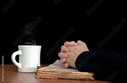 Fotografie, Tablou woman's praying hands on old Bible