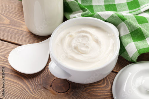 Fotografie, Obraz  Sour cream in a bowl and milk bottle