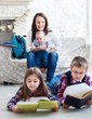 Children readind books in living room