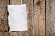 Lined Notepad On Old Wooden Background