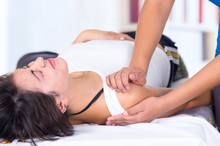 Woman In Pain Lying While Gett...