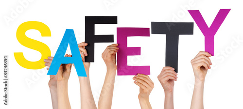 Fototapeta Many People Hands Holding Colorful Word Safety
