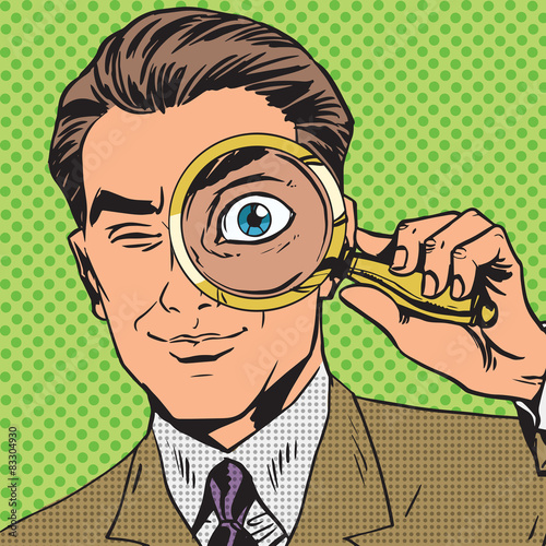 Photo  The man is a detective looking through magnifying glass search p