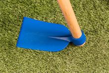 Blue Hoe On Artificial Grass
