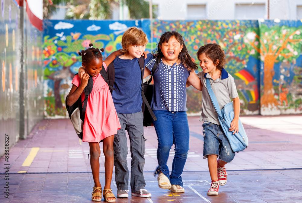 Fototapety, obrazy: Schoolchildren embracing happy. Multi cultural racial classroom