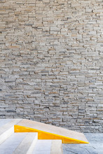 Brick Wall Pattern Of Exterior Building And Ramp Access For Disa