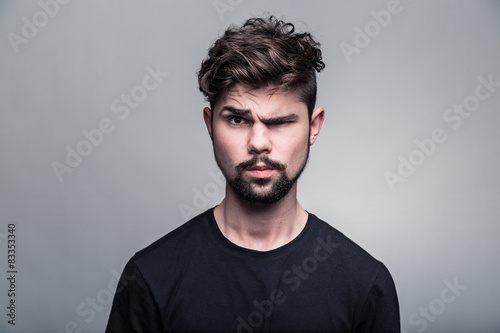 Fototapety, obrazy: Portrait of young man in  black T-shirt