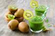 Green smoothie with kiwi horizontal on wooden background