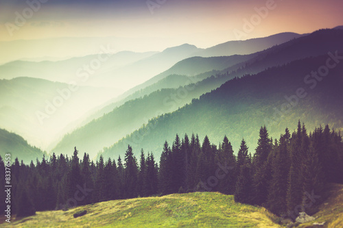 Photo sur Toile Aubergine Layers of mountain and haze in the valleys.