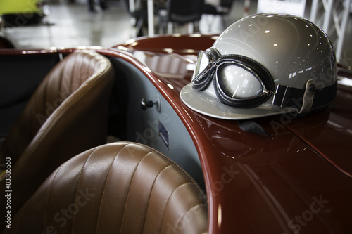 Poster Vintage voitures helmet and glasses on a luxury convertible sports car