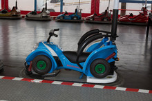 Blue Bumper Cars, New One Motorbike Style At The Fun Fair
