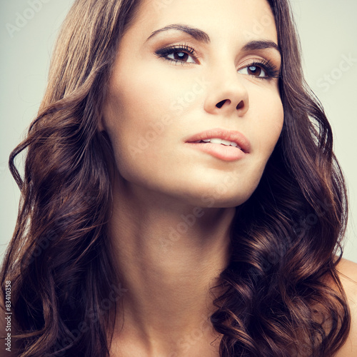 Fototapety, obrazy: Beautiful young woman with long curly hair