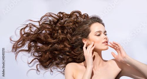 Fotografie, Obraz  The girl's hair fluttering in the wind flow