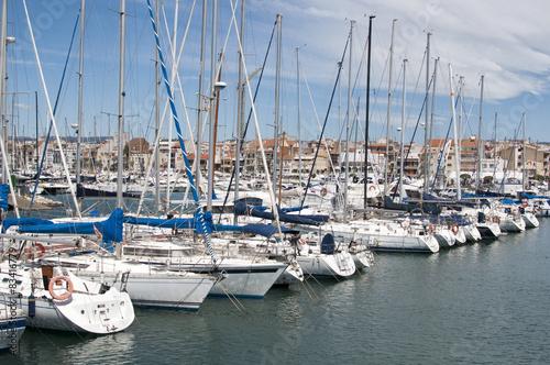 Sailing boats in Cambrils Harbour, Tarragona, Spain.