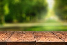 Empty Wooden Table With City P...