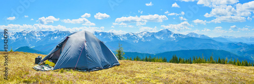 Poster Camping Panoramic view of tourist tent and a mountain range