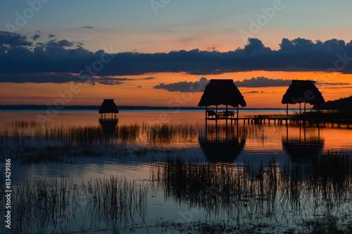 Foto op Plexiglas Crimson Sunset at the lake Peten Itza in El Ramate