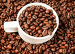 Cup with coffee beans, close up