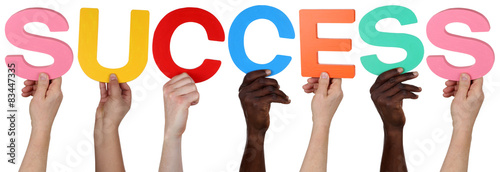 Multi ethnic group of people holding the word success #83447335
