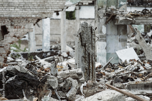 A closeup image of a ruined building with concrete and armature Fototapeta