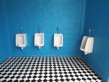 White Urinals In Men's Bathroom