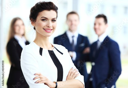 Fotografiet  Face of beautiful woman on the background of business people
