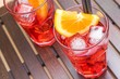 view of glasses of spritz aperitif aperol cocktail and orange