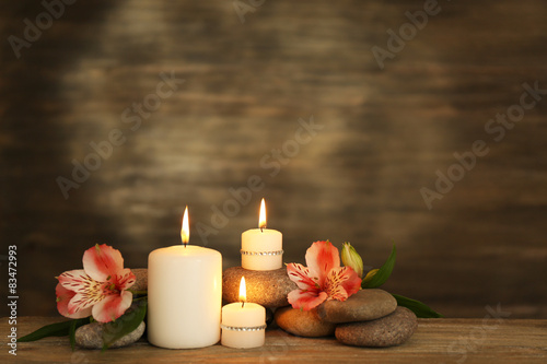 Foto op Plexiglas Spa Beautiful composition with candles and spa stones on wooden background