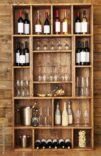 Canvas Prints Bar Shelving with wine bottles with glasses on wooden wall background
