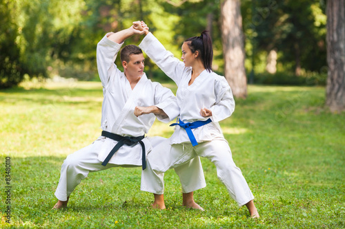 Deurstickers Vechtsport Two martial arts fighters practicing in nature